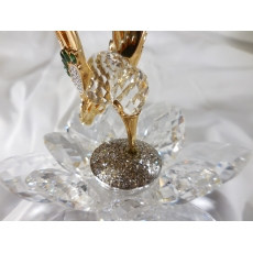 """This is a Rare Limited Edition Swarovski in Flight Hummingbird Gold and Crystal collectible. These were retired in 1988 now hard to find and going up in value. If your a Swarvoski collectible or love hummingbirds, this is a great piece to add to any collection. Beautiful clear crystals and brilliant gold on hummingbird. This was offered to the Swarovski Collecters Society """"SCS"""" members in 1985. hAS logo on bottom. Measures approx. 4"""" wide by 4"""" tall.  Condition: Still has same luster as when new, no signs of chips or scratches, because of it's age it's no Mint but very good conditon. Does have the original Swarovski box."""